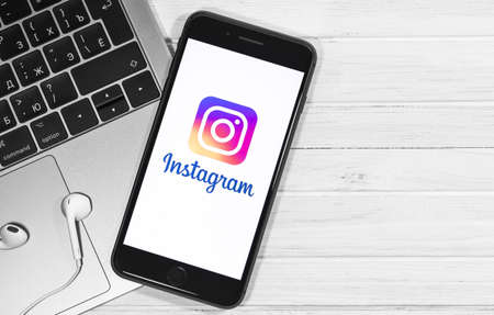 Instagram logo on the screen smartphone, notebook closeup. Social media. Instagram is a photo-sharing app for smartphones. Moscow, Russia - December 23, 2019