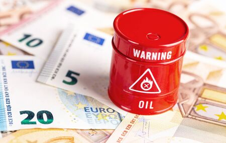 oil barrel with money, euro banknotes closeup background