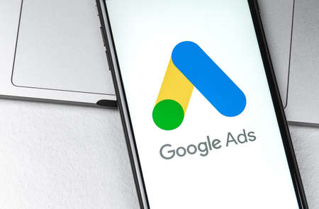 Google Ads (AdWords) logo on the screen smartphone closeup. Google Ads is a service of contextual, basically, search advertising from Google. Moscow, Russia - August 11, 2020