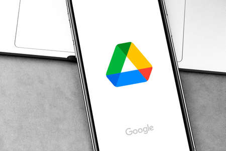 Google Drive logo app on the screen smartphone. Google Drive is a file storage, editing and synchronization service. Moscow, Russia - August 21, 2020 Editorial