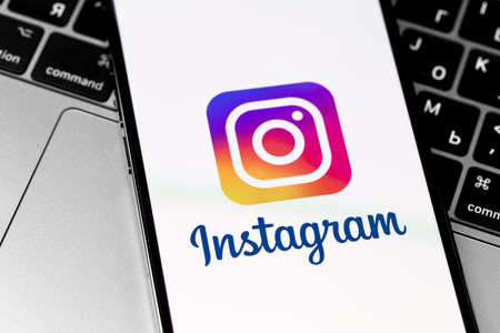 Instagram logo on the screen iPhone and MacBook closeup. Instagram is a photo-sharing app for smartphones. Moscow, Russia - November 28, 2020