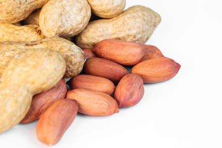 dried peanuts on white background closeup