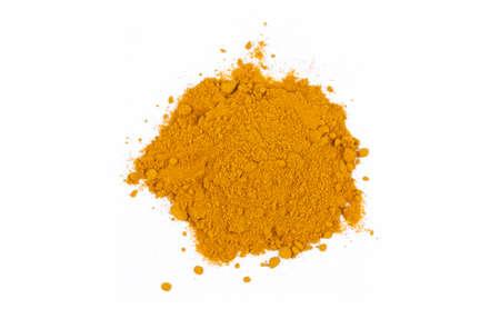 yellow turmeric powder on the white background