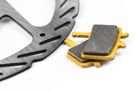 mountain bike, disk and pads brake on the white background, closeup