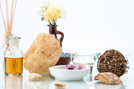 Body Care with loofah, scrub, essential oil, spa, Floating Flowers and Candle