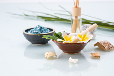 organic spa: Organic Spa concept with Mortar and Pestle, Flowers, leaf, Scented, and salt Stock Photo