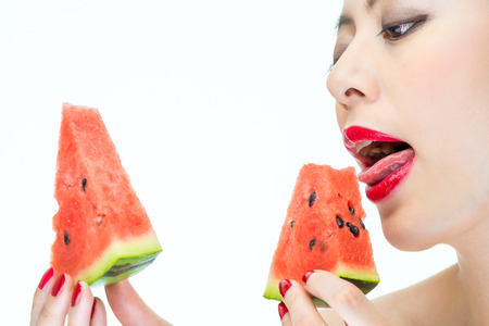 greedy: Fashion woman enjoy eating watermelon with red lips, Greedy, Licking