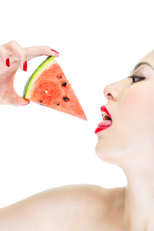 licking finger: woman desire eating watermelon with red lips, fashion Stock Photo