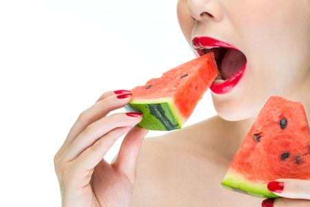 greedy: Fashion woman enjoy eating watermelon with red lips, Greedy, bite