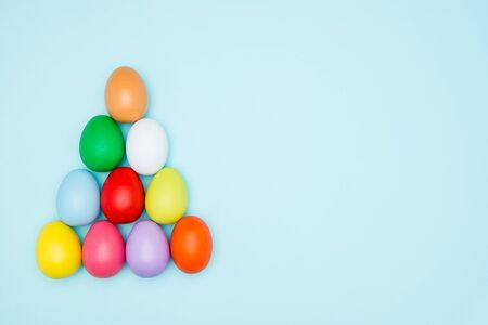 triangle shape: Colorful easter eggs on pastel background, Triangle Shape, copy space Stock Photo