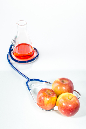 genetic food modification: Stethoscope with apples