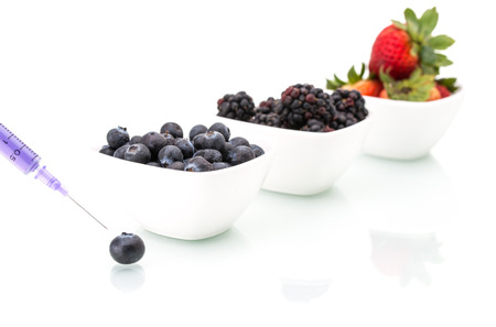 food science: Genetically modified food science of blueberry blackberry and strawberry Stock Photo