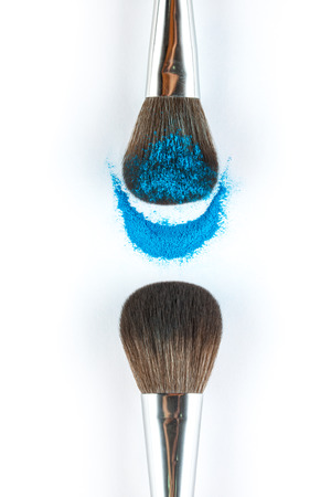blusher: blue Powder Eyeshadow on a Brush, fashion beauty  tool blusher Stock Photo