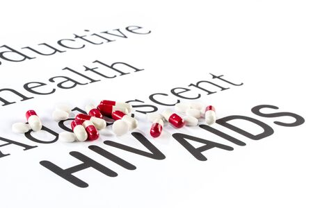 reproductive health: Reproductive health by Adolescent, AIDS HIV, medication sickness capsule on paper Stock Photo