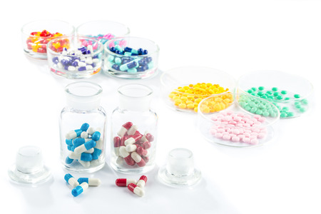 medicament: colorful capsule in Pill Container,  Healthcare And Medicine healthcare medicament Stock Photo