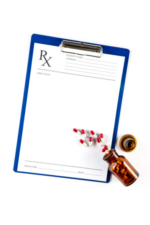 pad: Medical insurance and healthcare, RX form with Capsules and clipboard Stock Photo
