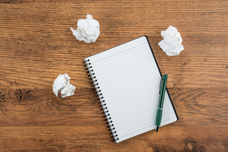 crumple: crumple white paper and pen with notebook on the desk