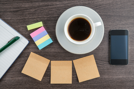 adhesive  note: Adhesive Note, notebook and smart phone with cup of coffee Stock Photo