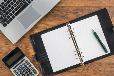pen and paper: notebook and pen with calculator on the desk finance plan