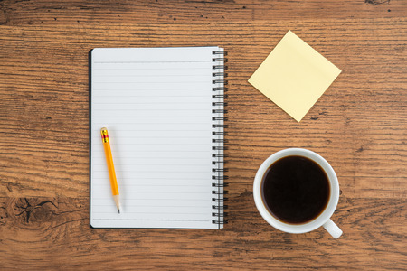 adhesive  note: Notebook with pencil Adhesive Note and cup of coffee, Planning Stock Photo