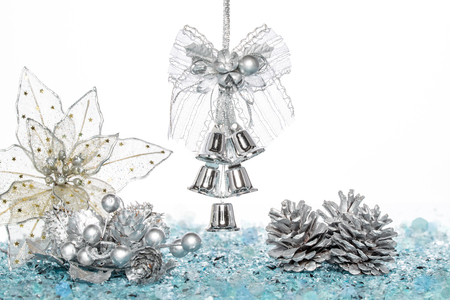 jingle bells: Luxury Silver jingle Bells, flower and Pine Cone on Snow, hanging Decoration, isolated on white