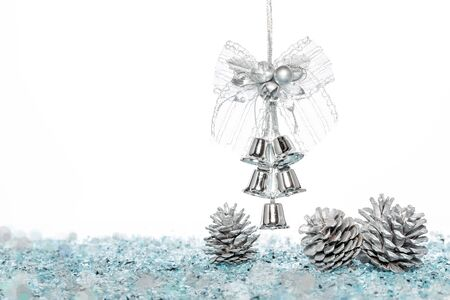 snow cone: Luxury Silver jingle Bells with Snow and Pine Cone, hanging Decoration, isolated on white