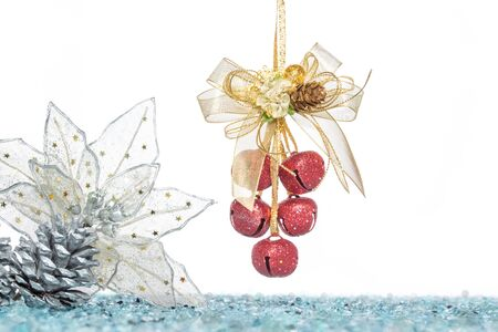jingle bells: Luxury red jingle Bells, flower and Pine Cone with Snow, hanging Decoration, isolated on white Stock Photo
