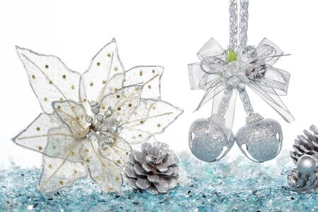 silver bells: Luxury Silver jingle Bells, flower and Pine Cone on Snow, hanging Decoration, isolated on white