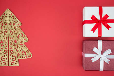 boxing day sale: Gift box for Christmas day sale and shopping boxing day on red background Stock Photo