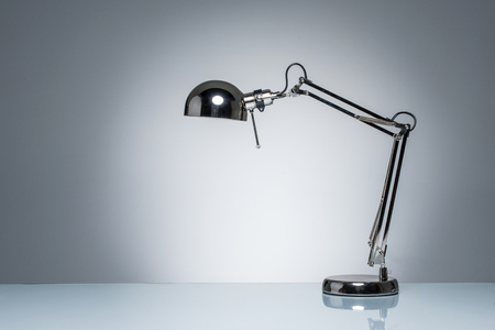 poise: lighting up office desk lamp for reading  studying on empty space Stock Photo