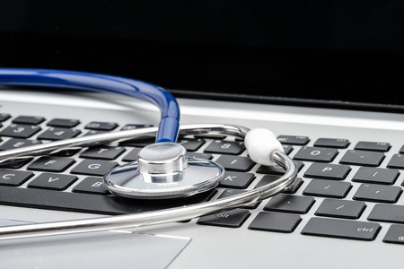 antivirus software: Medical Research, stethoscope on laptop keyboard, doctor workplace Stock Photo
