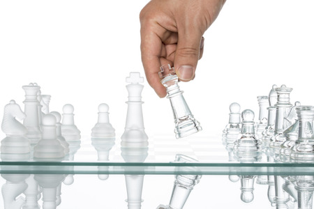 business Competition  Conflict, transparent glass Chess,  Reflection Copy Space Human Hand