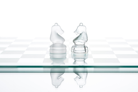two faced: two chess horses, business  face to face war confrontation