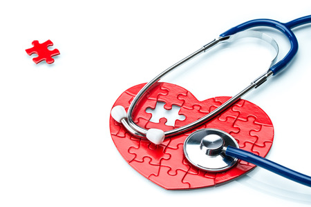 murmur: Heart disease, puzzle heart with stethoscope on white background