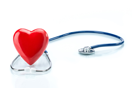 murmur: Red heart with stethoscope isolated on white background Stock Photo