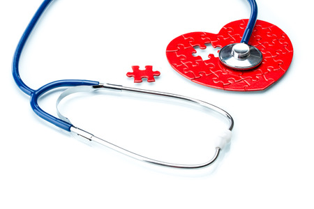 healthy arteries: Heart disease, puzzle heart with stethoscope on white background