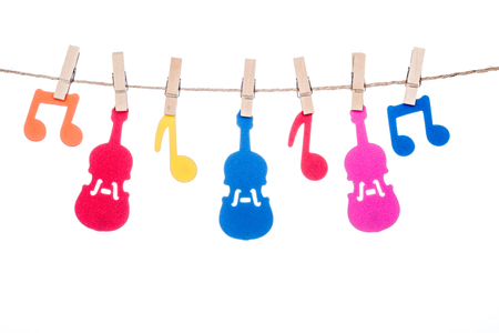 octaves: clip on a  twine, hanging colorful music symbol and Guitar artist Stock Photo