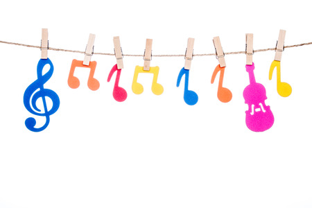 octaves: clip on a twine, hanging colorful music symbol artist Stock Photo