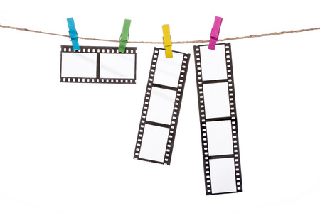 handled: colorful clothespins on a clothesline, hanging Photographic Negatives image