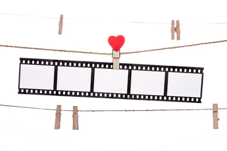 darkroom: heart shape clip on a clothesline with hanging Negatives film