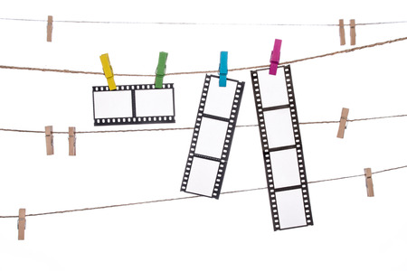 darkroom: colorful clothespins on a clothesline with hanging Photographic Negatives image