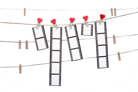 heart shape clip on a clothesline with hanging Negatives films Stock Photo