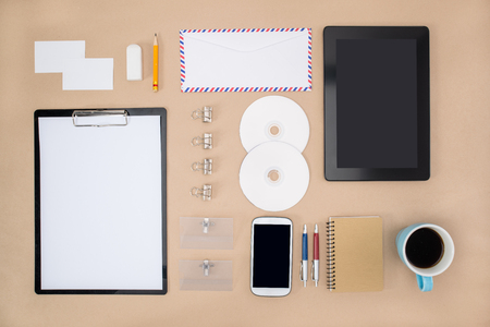 office supply: smart phone, tablet and Office Supply on the table
