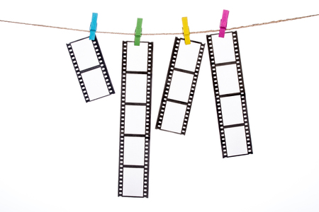 darkroom: colorful clothespins on a clothesline with hanging Photographic Negatives