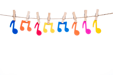 octaves: clips on a twine with hanging colorful music symbol Stock Photo