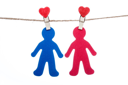sweet couple: heart shape clip on a twine with hanging sweet  COUPLE Stock Photo