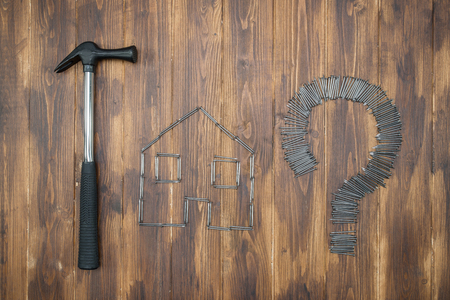 speculation: fight housing price hike question, cool real estate speculation, Group of nail Stock Photo