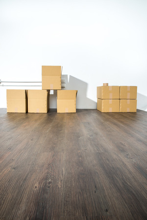 fragile industry: Pile of cardboard boxes on white background with box shadow