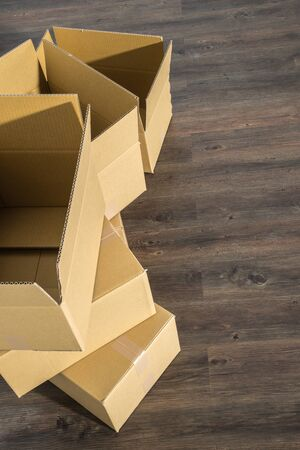 relocation: Pile of cardboard boxes on parquet  home relocation