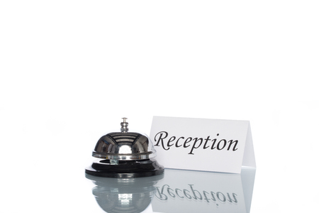 service desk: Service bell on the reception desk with white background Stock Photo